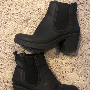 Heeled black booties